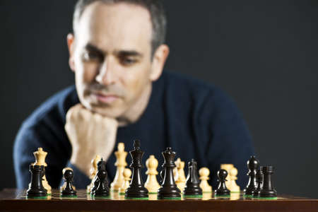 Chessboard with man thinking about chess strategy photo