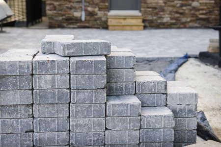 interlocking: Stacks of interlocking stones for installing driveway landscaping Stock Photo