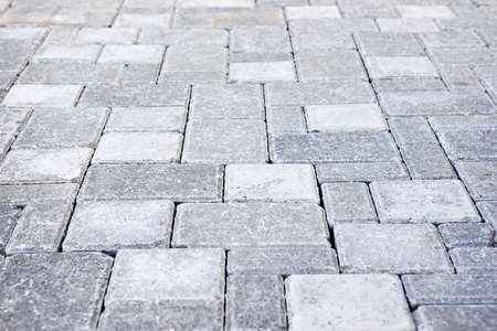 Gray interlocking paving stone driveway from above photo