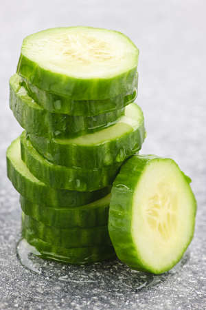 Stack of fresh organic green cucumber slices photo