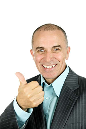 Portrait of smiling businessman giving thumbs-up isolated on white background Stock Photo - 7317242