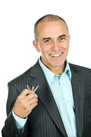 old people: Portrait of smiling businessman holding keys isolated on white background