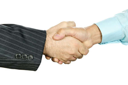 Closeup of two businessmen shaking hands in agreement photo