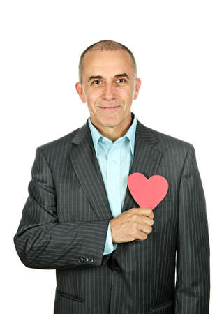 Smiling man holding paper heart isolated on white background photo