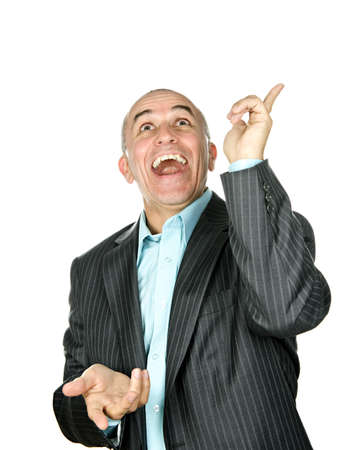 Portrait of laughing businessman pointing up isolated on white background photo