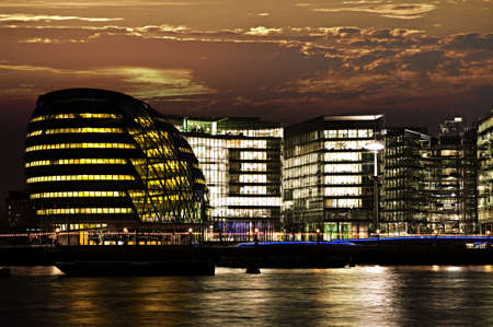 New London city hall at night from Thames river photo