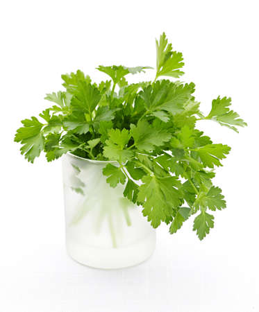 Fresh green parsley in glass isolated on white background photo