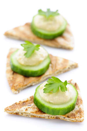 canape: Appetizer of hummus and cucumber slices on pita bread Stock Photo