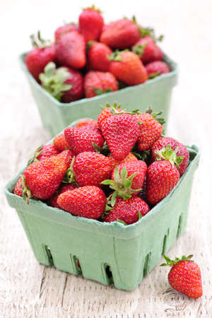 Two containers of fresh organic red strawberries Stock Photo - 7372876