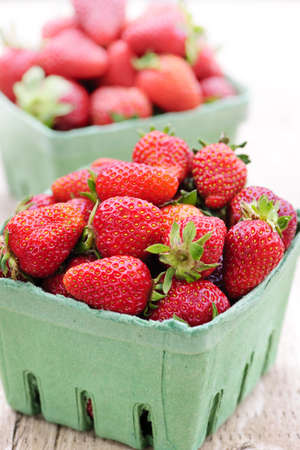 Two containers of fresh organic red strawberries photo