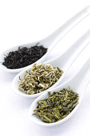 Black, white and green dry tea leaves in spoons Stock Photo - 7372780