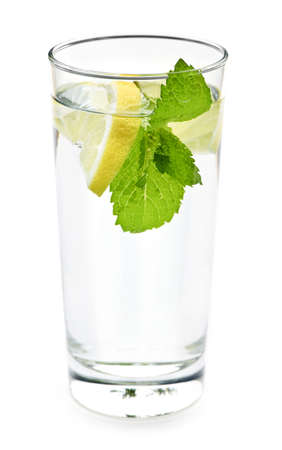 minty: Full glass of water with lemon and mint isolated on white background