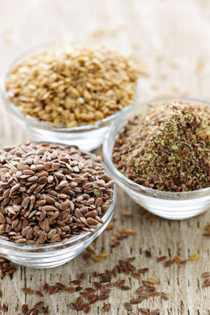 linseed: Bowls of whole and ground flax seed or linseed
