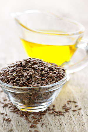 Bowl of brown flax seed and linseed oil Stock Photo - 7372947