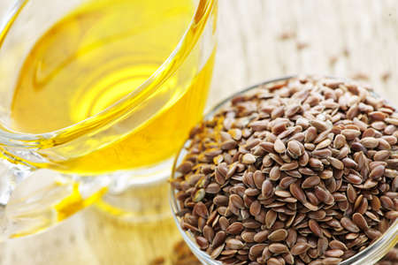 Bowl of brown flax seed and linseed oil Stock Photo - 7372956