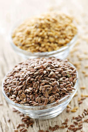 Bowls full of brown and golden flax seed or linseed Stock Photo - 7372959