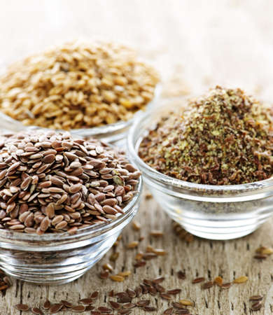 Bowls of whole and ground flax seed or linseed