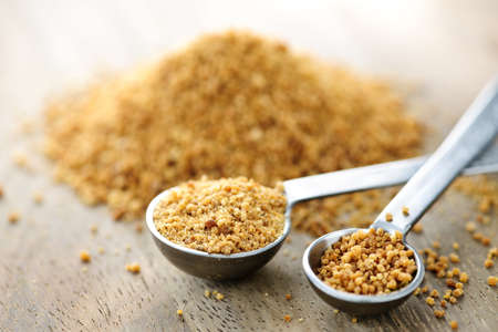 Organic coconut palm sugar in measuring spoons photo
