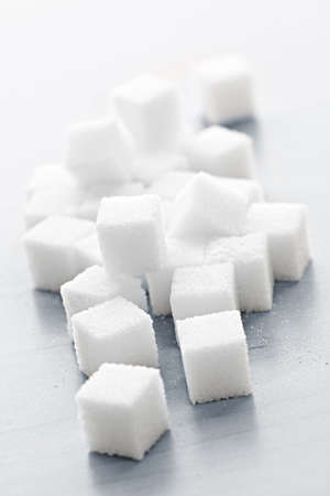 Close up of many white sugar cubes photo