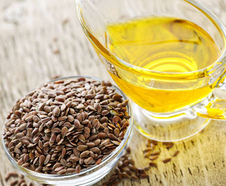 Bowl of brown flax seed and linseed oil Stock Photo - 7608382
