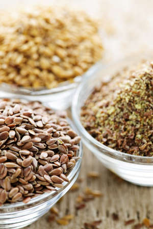 Bowls of whole and ground flax seed or linseed Stock Photo - 7608384