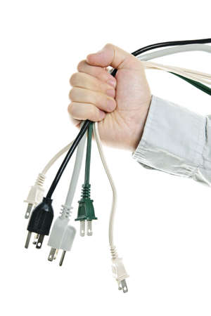 Hand holding bundle of power cables isolated on white background