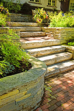 stone stairs: Natural stone landscaping in home garden with stairs