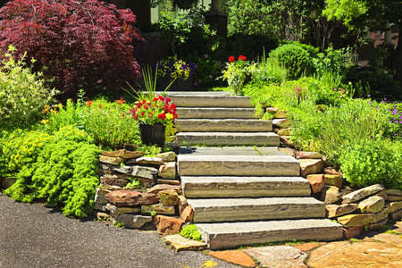 Natural stone landscaping in home garden with stairs photo