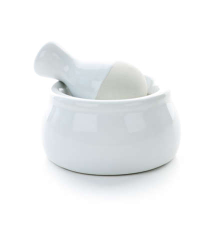 trituration: White ceramic mortar and pestle isolated on white background