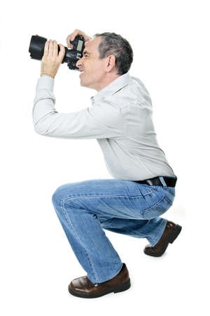 take action: Portrait of male photographer with camera isolated on white background