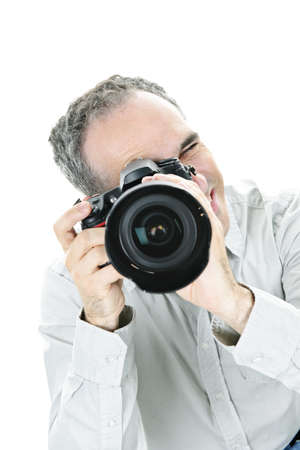 Portrait of male photographer with camera isolated on white background Stock Photo - 7675419