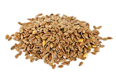 Heap of brown flax seed or linseed isolated on white background photo