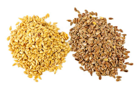 linseed: Heaps of brown and golden flax seed or linseed isolated on white background
