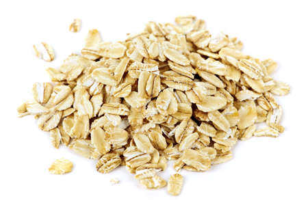 roll: Heap of dry rolled oats isolated on white background