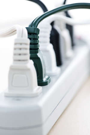 Many plugs plugged into electric power bar Stock Photo - 7701743