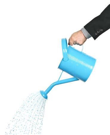 spray can: Hand of a businessman pouring water from watering can