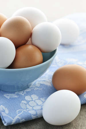Closeup of white and brown eggs in bowl