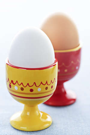 Closeup of two soft boiled eggs in cups