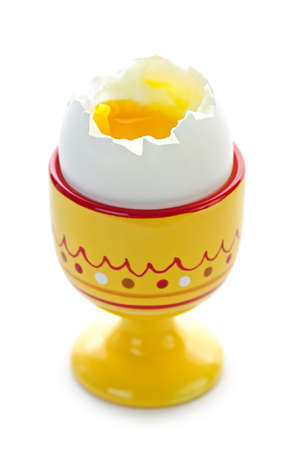 Closeup of soft boiled egg in cup isolated on white background Stock Photo - 7745752