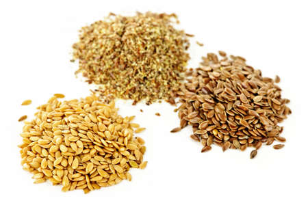 Heaps of brown, golden and ground flax seed or linseed isolated on white background Stock Photo - 7745481