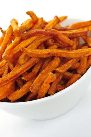 Closeup of sweet potato or yam fries in white bowl photo