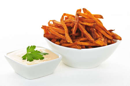 sweet potatoes: Bowl of sweet potato or yam fries with dipping sauce