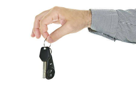 Hand holding car key and remote entry fob isolated on white background photo