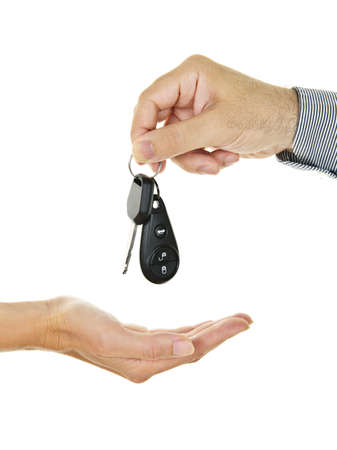 Male hand giving car key to female hand photo