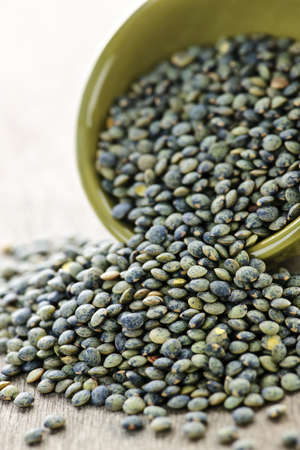 heaping: Bowl full of raw french green lentils