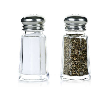 Glass salt and pepper shakers isolated on white background photo