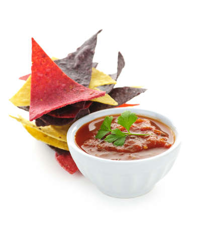 Bowl of salsa with colorful tortilla chips isolated on white background photo
