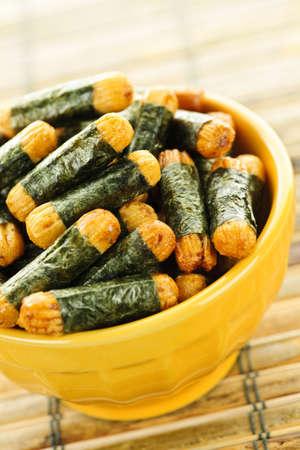 Bowl of Japanese rice and seaweed crackers Nori Maki