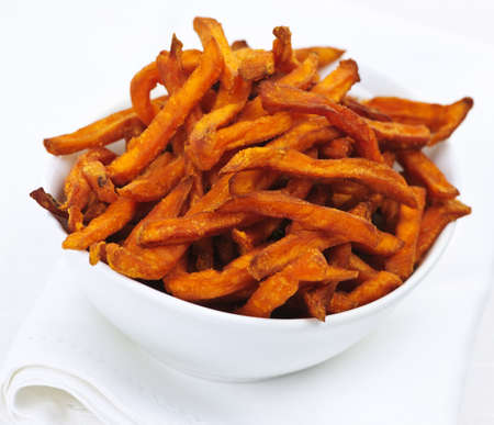 Closeup of sweet potato or yam fries in white bowl photo