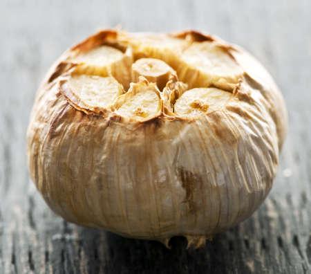 Close up of fresh roasted garlic bulb photo